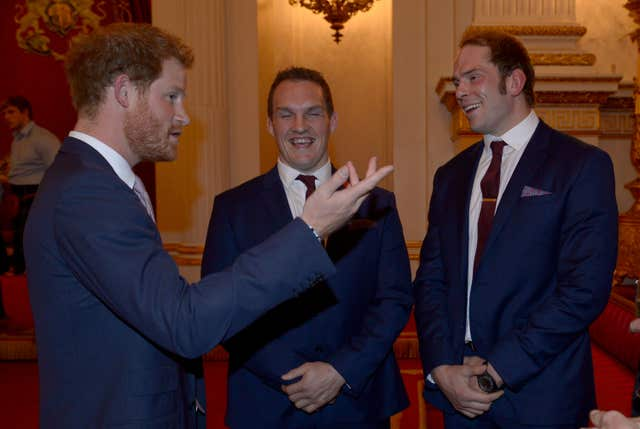 Alun Wyn Jones and Wales team-mate Gethin Jenkins, centre, meet Prince Harry, left