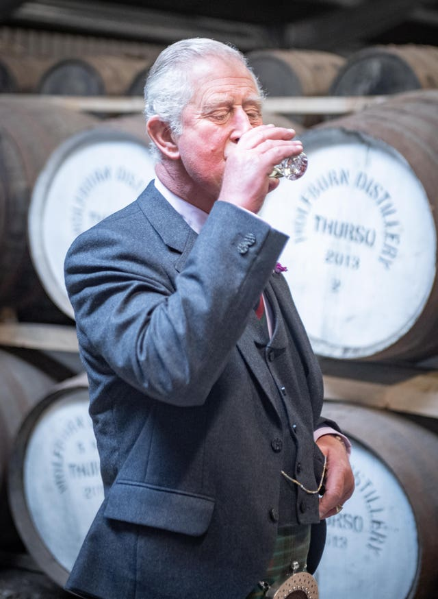 Prince Charles drinking whisky