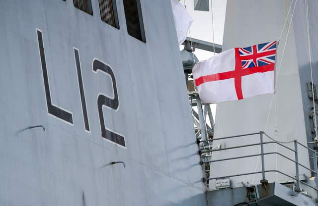 The Ensign is lowered at the decommissioning ceremony for HMS Ocean (Andrew Matthews/PA)