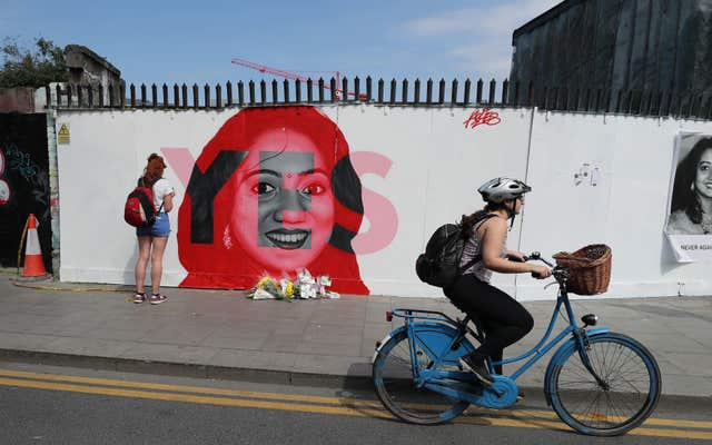 People pass a mural of Savita Halappanavar in Dublin (Niall Carson/PA)