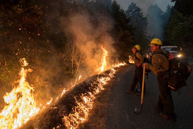 Firefighters monitor a controlled burn in California
