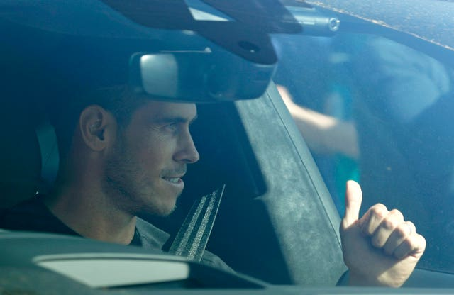 Gareth Bale gives a thumbs up to fans as he arrives at the training ground