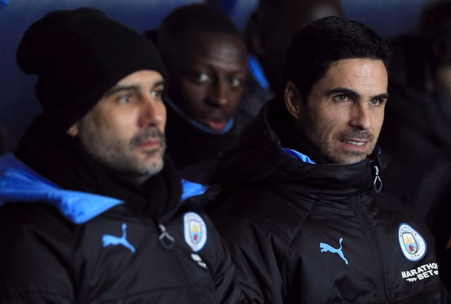 Manchester City manager Pep Guardiola with then assistant Mikel Arteta (right)