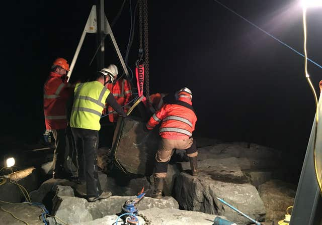 A seal pup being rescued from under a one-tonne boulder near Port Talbot steelworks in South Wales
