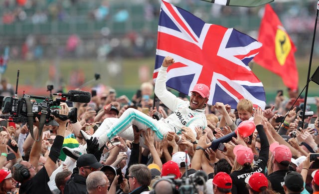 Mercedes driver Lewis Hamilton celebrates winning the British Grand Prix in 2019