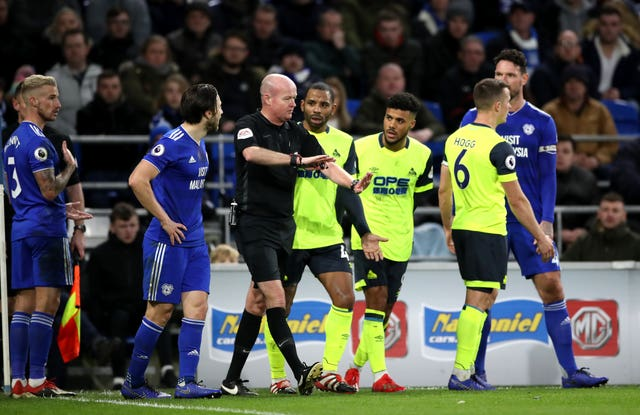 Referee Lee Mason overturns the penalty award to Huddersfield in their match at Cardiff (Nick Potts/PA).