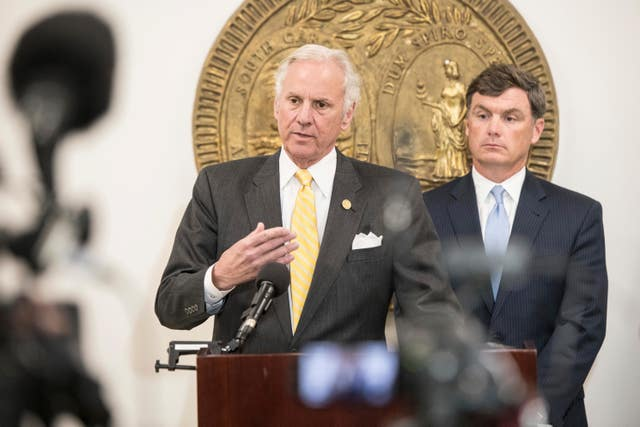 South Carolina governor Henry McMaster, left, and Department of Corrections director Bryan Stirling address the media (Sean Rayford/AP)