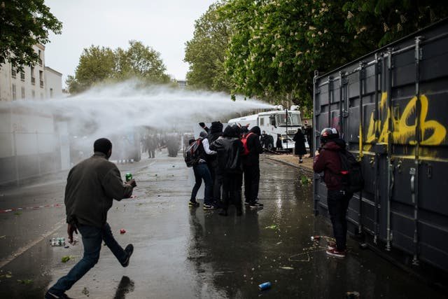 Police use a water cannon at the Place de la Nation in Paris