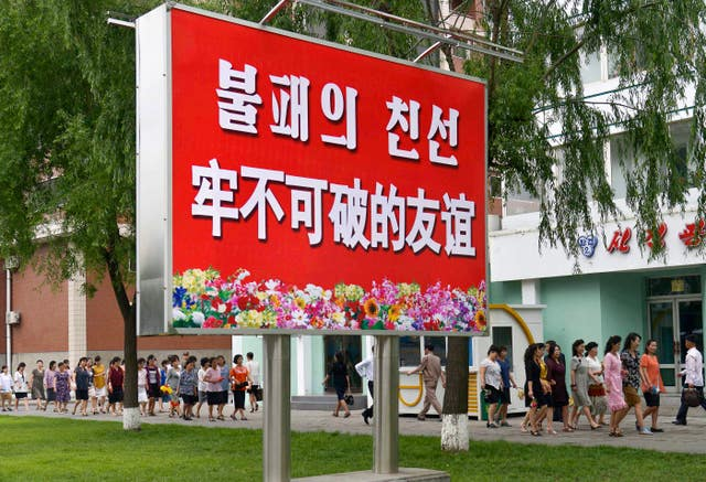 A signboard in Pyongyang reading 'Unbreakable friendship' in Chinese and Korean