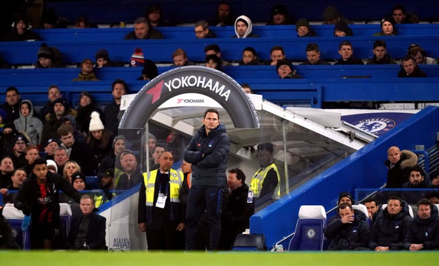 A disappointed Lampard watches on