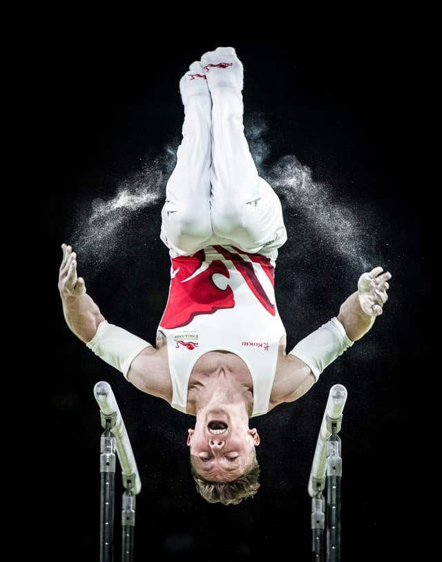 Nile Wilson competes in the parallel bars in which he won one of five medals at April's Commonwealth Games on Australia's Gold Coast. Wilson took silver on the apparatus and the rings, plus gold medals in the all-around, horizontal bar and the men's team gold, to show British men's gymnastics is not all about Max Whitlock