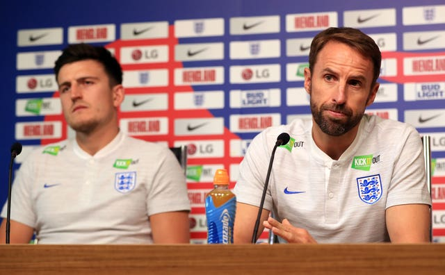 Gareth Southgate, right, was forced into a selection U-turn on Maguire