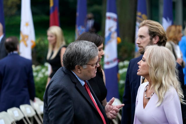 Attorney General William Barr speaks with Kellyanne Conway after President Donald Trump announced Judge Amy Coney Barrett as his nominee to the Supreme Court