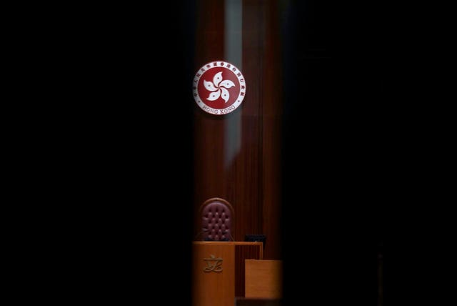 The logo of the Hong Kong Special Administrative Region is seen through the glass of a closed door after the first and second meeting of the Improving Electoral System (Consolidated Amendments) Bill 2021 finished at the Legislative Council in Hong Kong