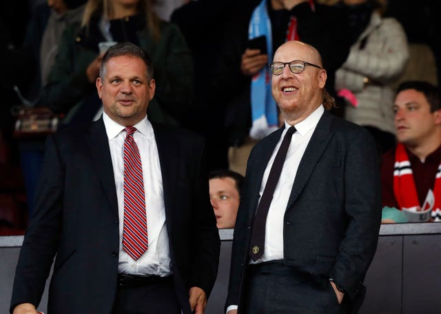Manchester United co-chairman Avram Glazer (right) pictured at a match at Old Trafford