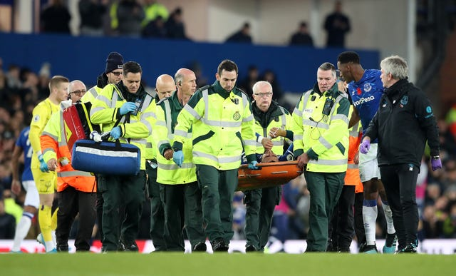 Andre Gomes is carried off the field after suffering a horrific injury against Tottenham last month