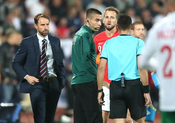 Gareth Southgate and Harry Kane speak to Croatian referee Ivan Bebek during the Euro 2020 qualifier in Sofia