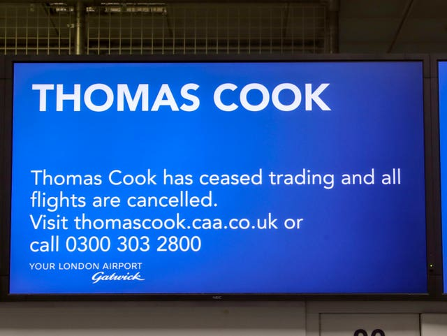 A sign at the empty Thomas Cook check-in desks at Gatwick (Steve Parsons/PA)