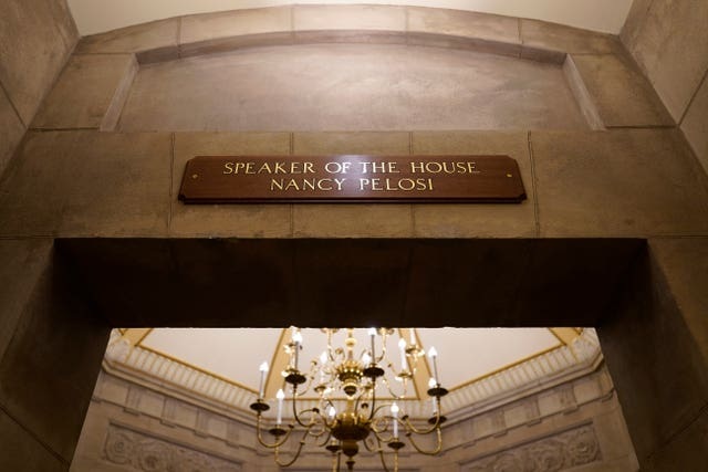 A view of the new sign marking the office for House Speaker Nancy Pelosi of Calif., from inside the US Capitol in Washington, Monday, Jan. 18, 2021. The new sign replaces the one that was destroyed when rioters stormed the Capitol