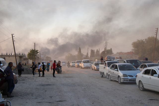 Syrians flee shelling by Turkish forces in Ras al Ayn, north east Syria