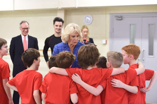 The Duchess of Cornwall chats to boys taking part in the Project B initiative (Eddie Mulholland/Daily Telegraph/PA)