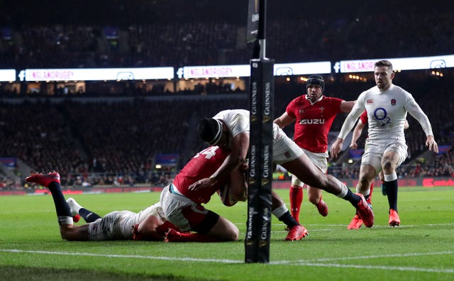 England's Manu Tuilagi (centre) was sent off for a dangerous tackle on Wales wing George North