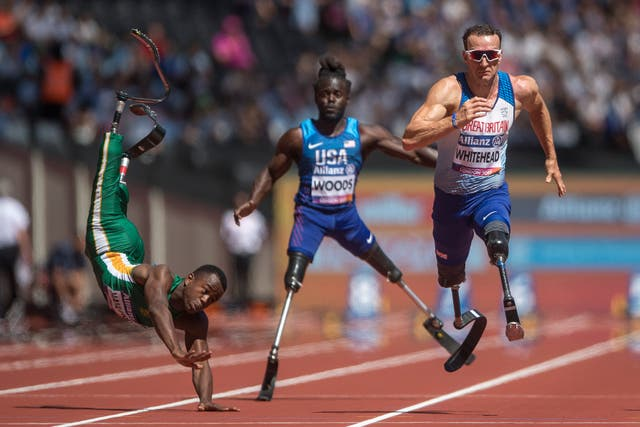 South Africa's Ntando Mahlangu takes a dramatic tumble during the 2017 World Para Athletics Championships at London Stadium. Great Britain's Richard Whitehead, right, went on to win the men's 100m T42 first heat during day four of the competition