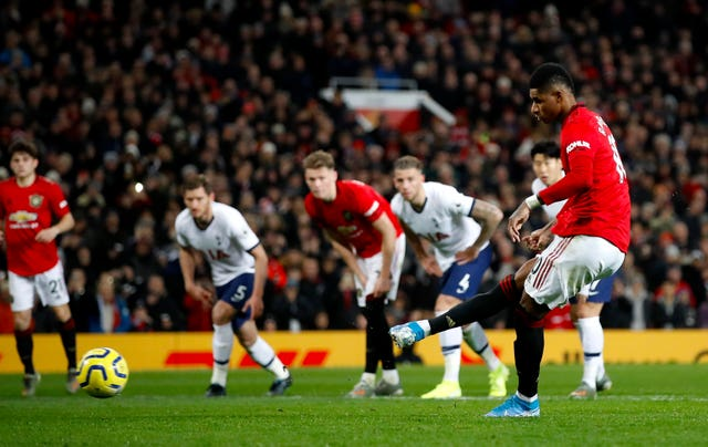 Marcus Rashford slots home the second-half penalty