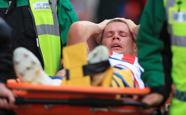 Stoke's Ryan Shawcross is stretchered off injured during the pre-season friendly against Leicester