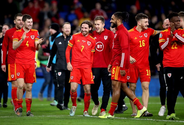 Wales players celebrate after securing qualification with a win over Hungary