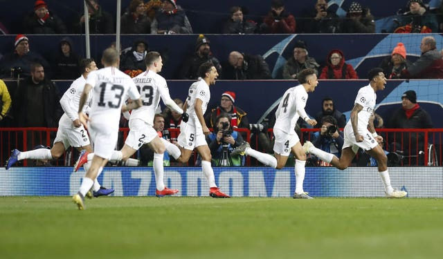 Paris St Germain's players celebrate Presnel Kimpembe's goal against Manchester United