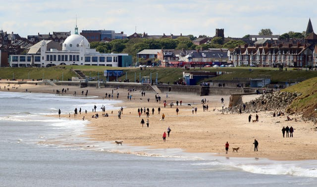 People on the beach at Whitley Bay