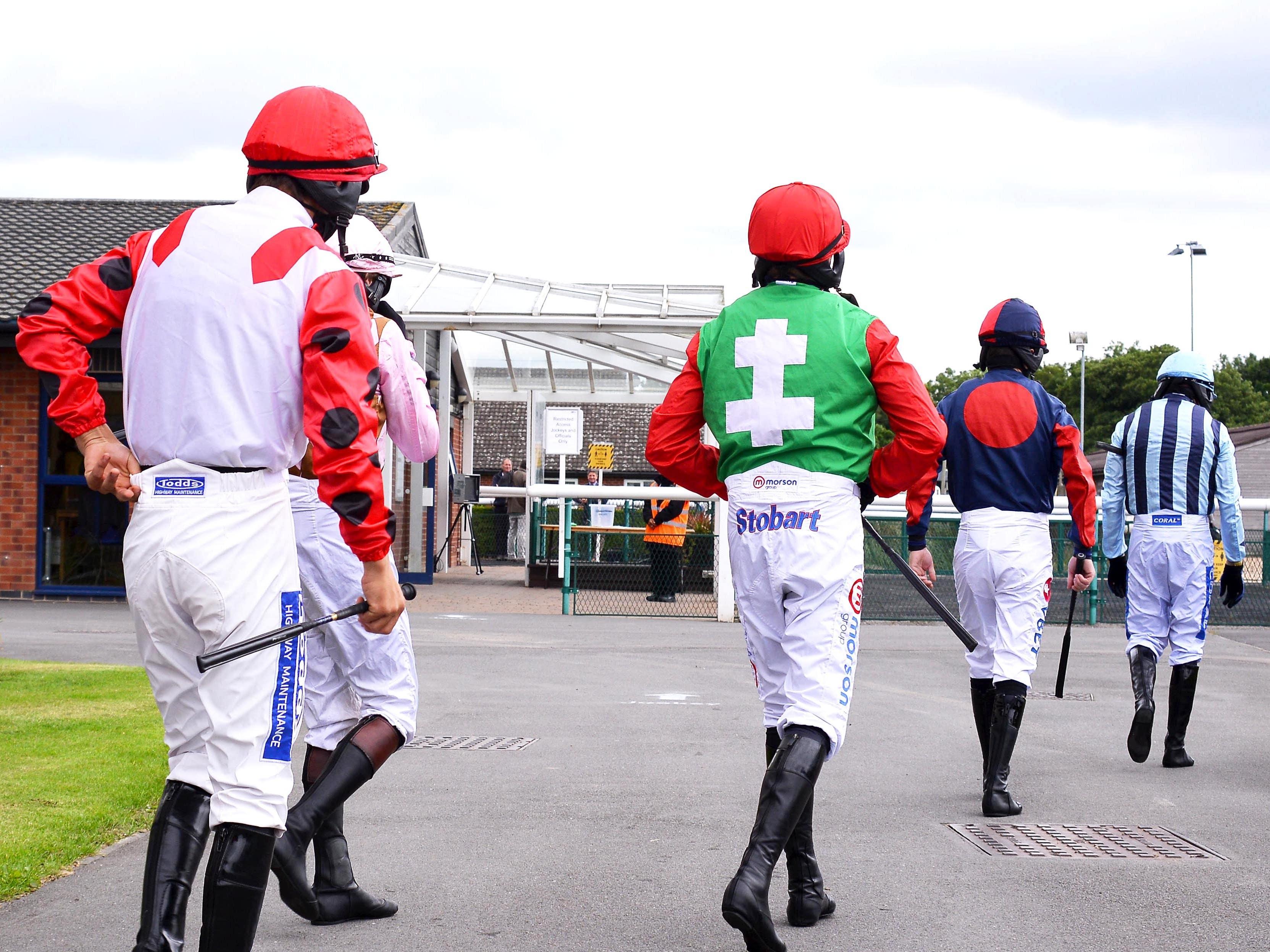 A jockey has tested positive for coronavirus (Tony Knapton/PA)