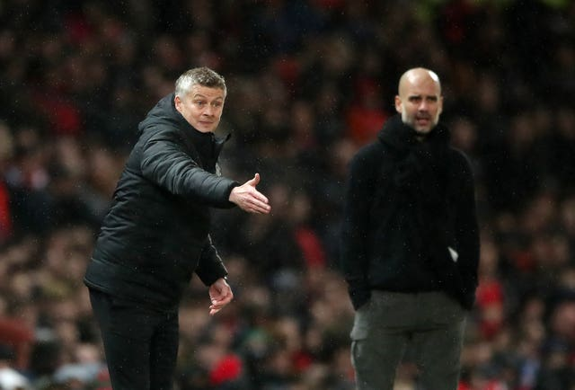 Manchester United manager Ole Gunnar Solskjaer, left, and Pep Guardiola