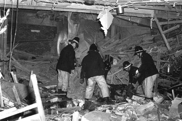 Firemen at work following the bombings