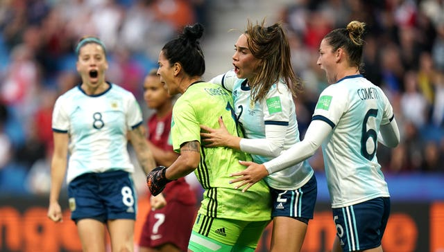 Vanina Correa, centre, celebrates after saving the penalty against England