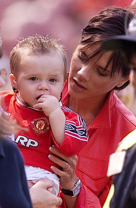 Man U v Spurs Posh Beckham & son