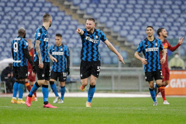 Milan Skriniar celebrates scoring for Inter