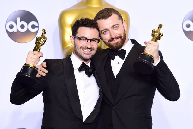 Sam Smith (right) and Jimmy Napes (left) with the Academy Awards for Best Original Song