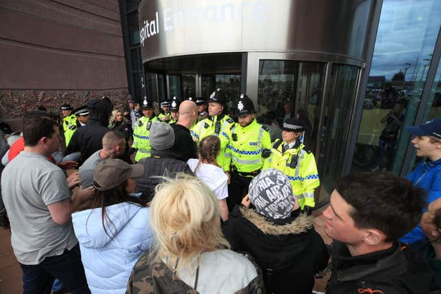 Police try to block protesters from the entrance to Alder Hey Children's Hospital in Liverpool (Peter Byrne/PA)