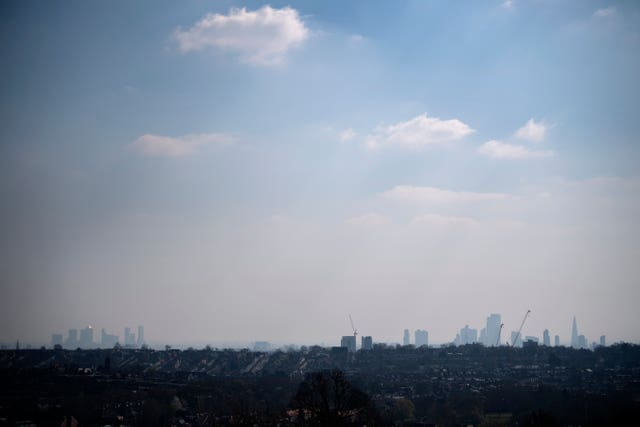 The London skyline viewed through the haze from Alexandra Palace, north London (Victoria Jones/PA)