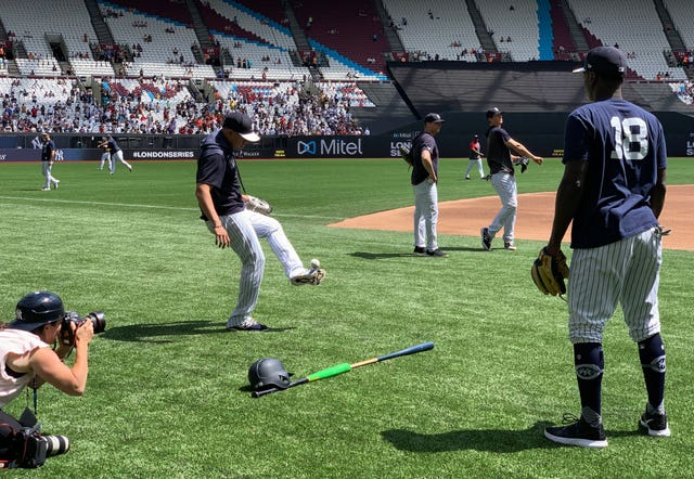 The New York Yankees' Gio Urshela, left, and Didi Gregorius play football as they warm up to face the Boston Red Sox