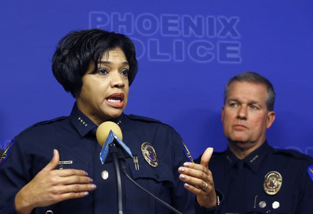 Phoenix police chief Jeri Williams, left, announces the arrest of Nathan Sutherland