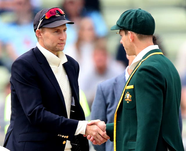 Joe Root, left, shakes Tim Paine's hand at the toss