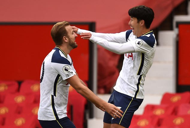 Son, right, celebrates with Kane after scoring his side's second goal at Old Trafford