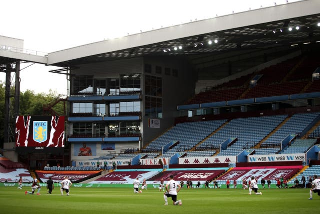 Aston Villa and Sheffield United players take a knee before kick-off in front of empty stands