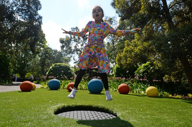 A child on a trampoline in the new garden