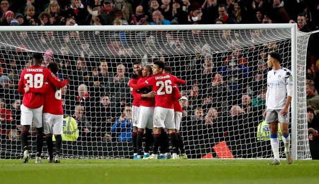 Manchester United celebrate Anthony Martial wrapping up a 3-0 win against Colchester