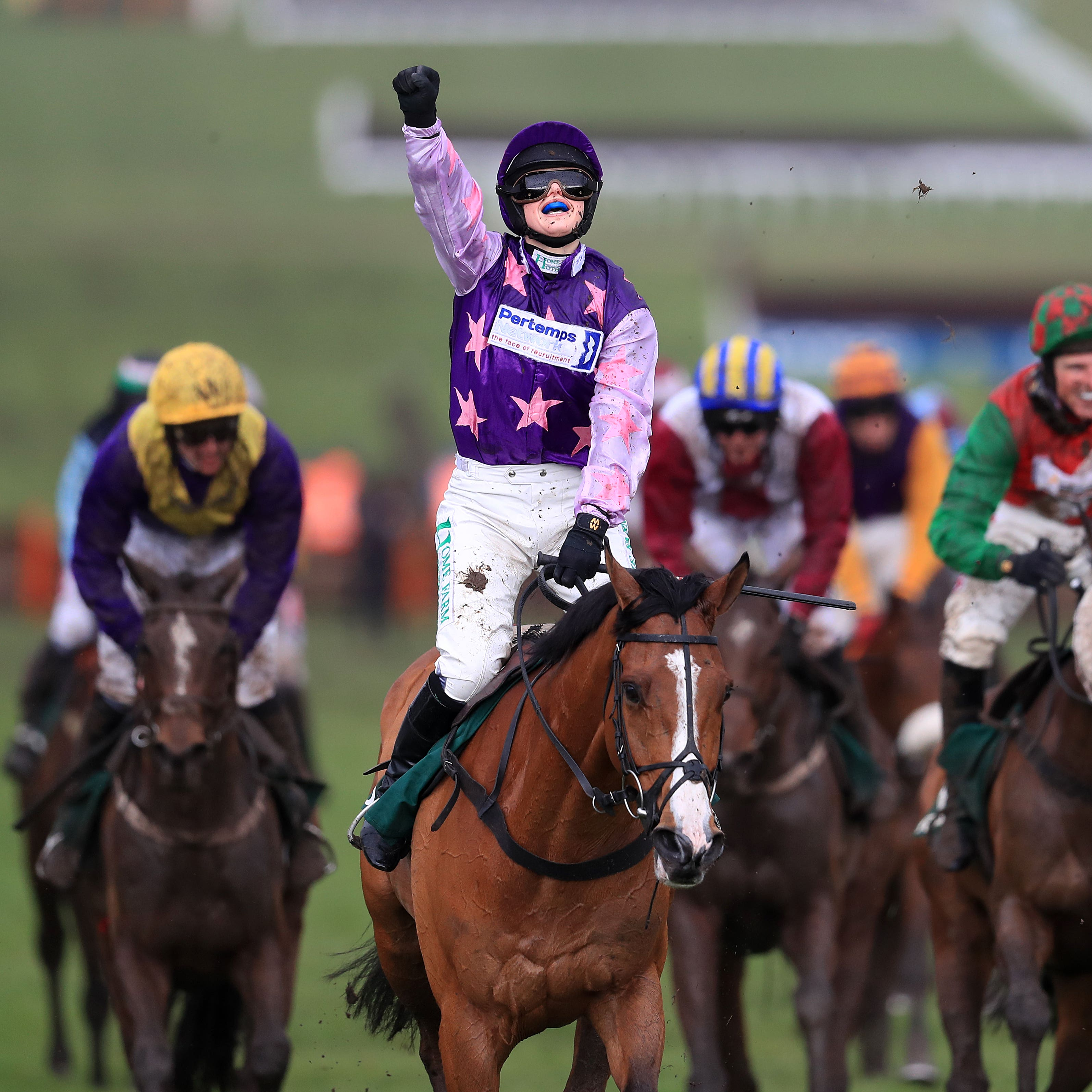Bridget Andrews celebrates after winning the County Hurdle on Mohaayed
