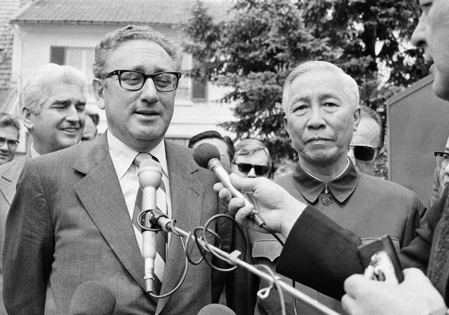 Henry A Kissinger, left, and Le Duc Tho (Michel Lipchitz/AP)